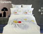 Decorate with Curiosita bedding ensemble for an innocent and charming look of your bedroom's decor, featuring bright ladybugs flirting with motifs of Chamomile Flowers on a white backdrop.