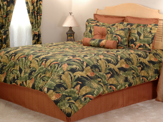 Features a rainforest like print in shades of green and russet brown on a black background.